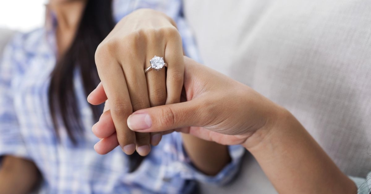 13917-engaged-ring-couple-proposal-marriage-jewelry-money.1200w.tn