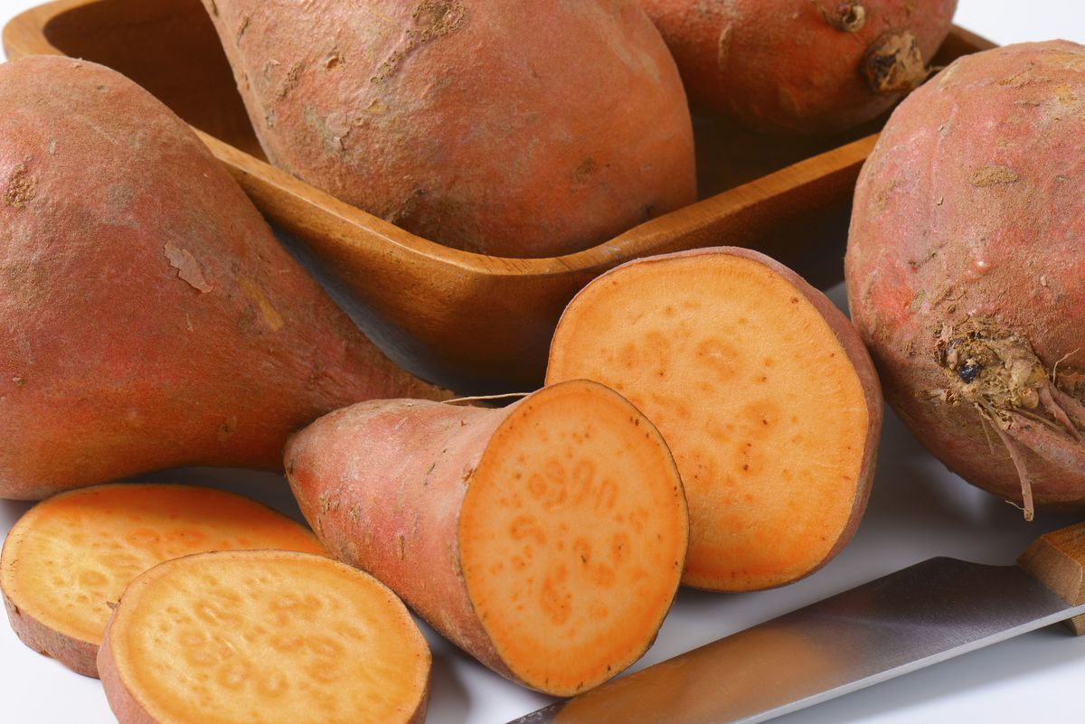 Sweet potatoes with orange flesh (rich source of vitamin A)