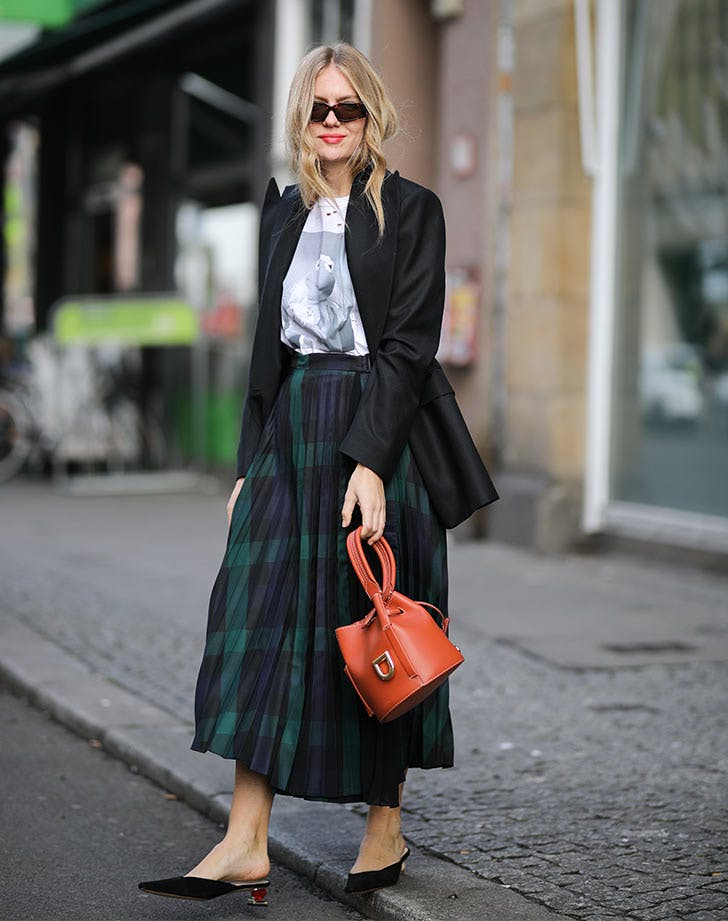 woman-wearing-plaid-skirt-t-shirt-and-blazer