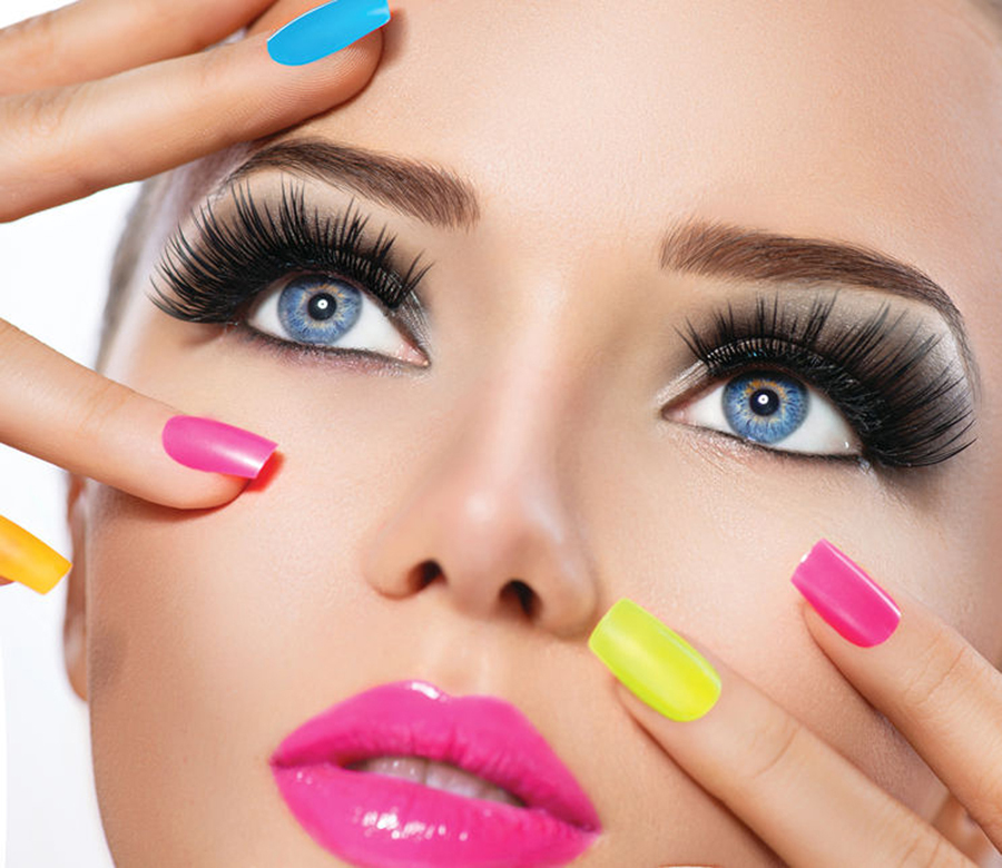 34792159 - beauty girl portrait with vivid makeup and colorful nail polish