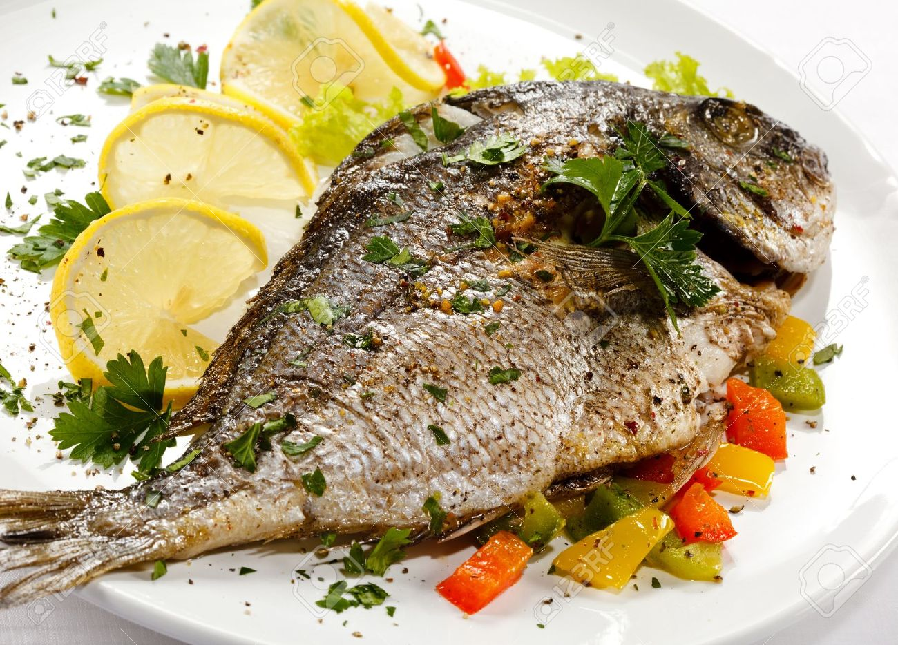 15564113-fish-dish-roasted-fish-and-vegetables-stock-photo-grilled