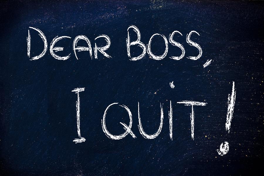 chalk writings on blackboard: Dear boss I quit