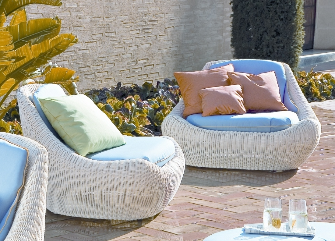 modern-pool-affordable-furniture-using-rounded-design-white-rattan-patio-chairs-with-blue-upholstered-cushions-and-orange-pillow