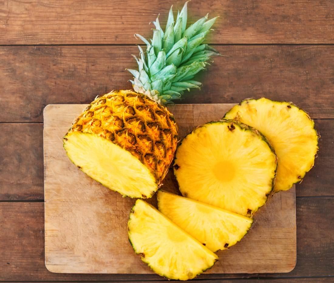 fresh-pineapple-sliced-on-chopping-board
